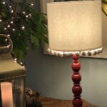 ivory linen with pom on red bobble lamp base